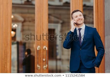 Pozitív jóképű férfi bank kezelő mobiltelefon Stock fotó © vkstudio