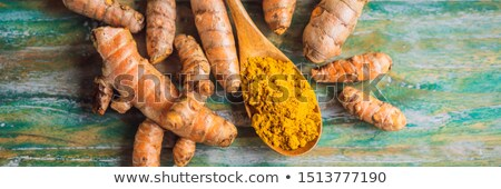 Ginger root and powder. Turmeric root and powder. On a colored wooden background BANNER, LONG FORMAT Stock photo © galitskaya