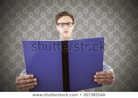Eccentric, young nerd reading a book Stock photo © konradbak