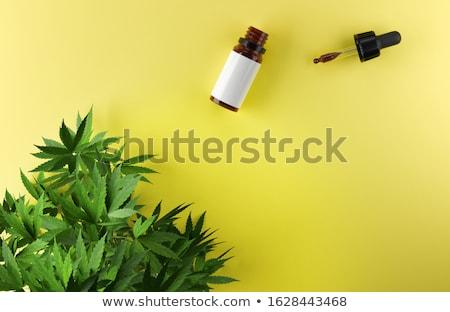 CBD, Cannabidiol oil bottles with a hemp leaf. 3d illustration. Stock photo © limbi007