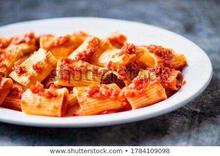 rustic italian paccheri pasta in tomato sauce Stock photo © zkruger