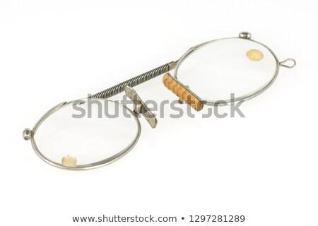 Antique reading glasses isolated Stock photo © backyardproductions