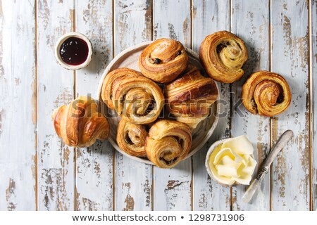 Croissant over wooden background Stock photo © aladin66