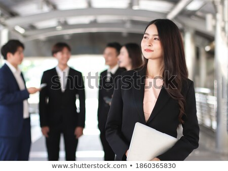 smiling businesswoman outside with her team stock photo © photography33