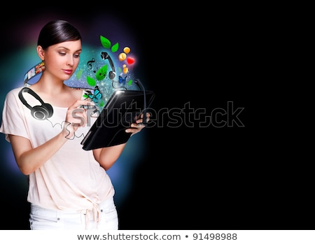 poster photo of young pretty woman using her tablet computer and stock photo © hasloo