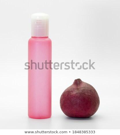 Stock photo: Cosmetic bottles and veggies