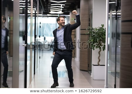 Young businessman rejoicing Stock photo © photography33