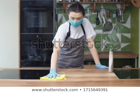 Homemaker wearing rubber gloves Stock photo © photography33