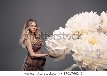 grávida · menina · em · pé · flores · feliz - foto stock © privilege