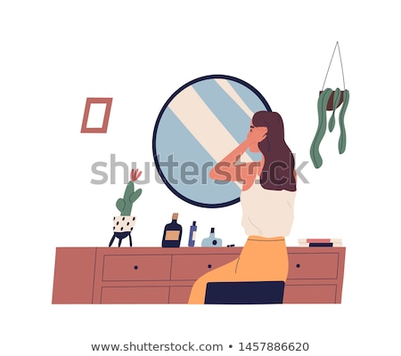 woman sitting and looks in the mirror Stock photo © privilege