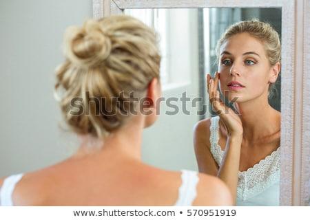 Mulher olhando cara espelho mão Foto stock © privilege