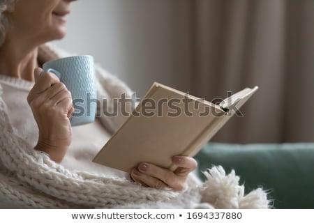 Okuma kitap düşler oturma tablo Stok fotoğraf © privilege