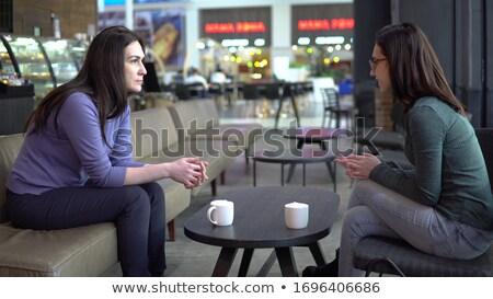 Adulto mulheres sentar-se tabela falar belo Foto stock © privilege