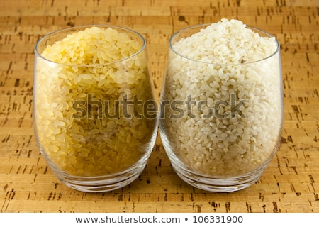 Two varieties of rice inside two transparent glasses Stock photo © Armisael