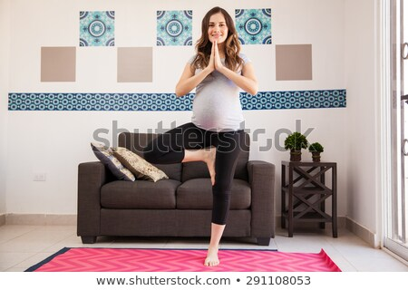 Stock photo: Gorgeous pregnant woman doing yoga