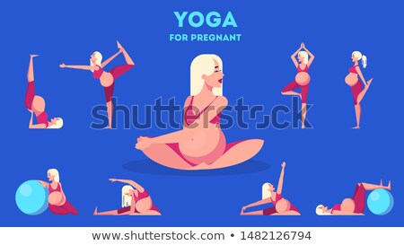Healthy pregnant woman doing gymnastics stock photo © stockyimages