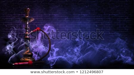 Dohányzás vízipipa fiatalember víz arc fej Stock fotó © csakisti