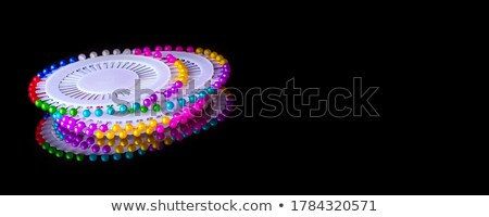 Stock photo: Lot of colorful pins on a black background