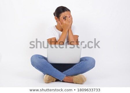 Woman peering at her laptop Stock photo © photography33