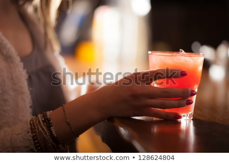 Woman holding up a mixer Stock photo © photography33