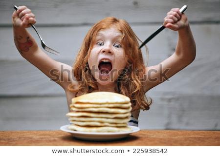 Kislány eszik palacsinta étel fiatal reggeli Stock fotó © photography33