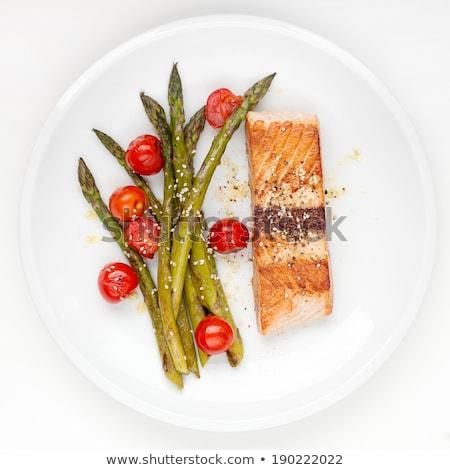 raw red fish on white plate stock photo © ozaiachin