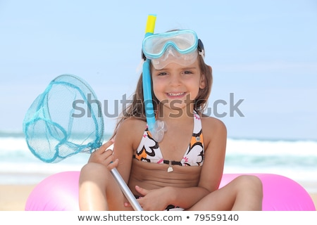 Young girl on the beach with snorkel, mask and fishing net Stock photo © photography33