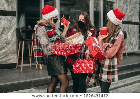 Stock photo: Christmas Shopping santa woman.