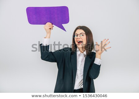 attractive young businesswoman holding blank billboard stock photo © williv