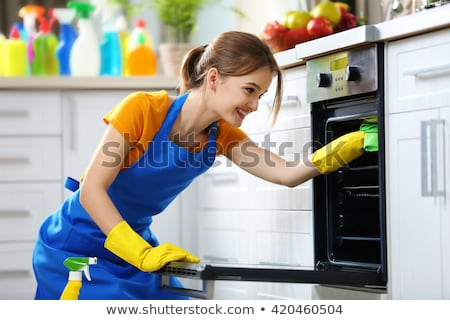 Young woman cleaning the oven  Stock photo © wavebreak_media