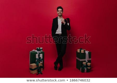 Lovely brunette in black leggings. Isolated Stock photo © acidgrey