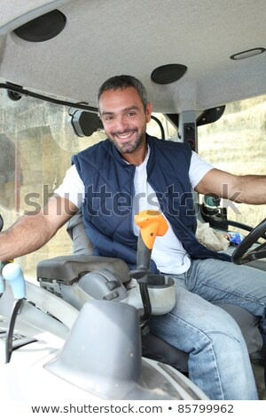 Farmer in the cab of his tractor Stock photo © photography33