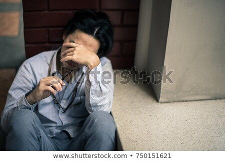 Lonely sad man in his place Stock photo © konradbak