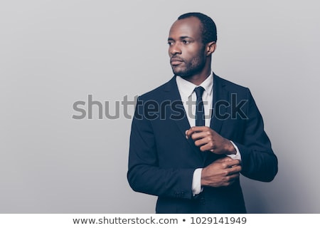 Young man fixed tie Stock photo © Anna_Om