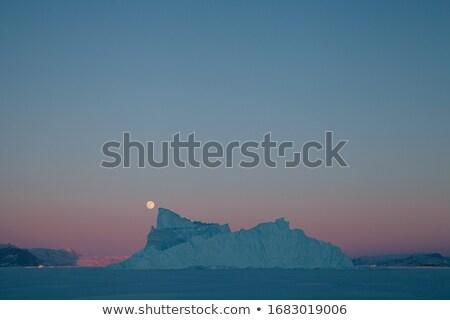 Ijsberg zonsondergang beroemd naast stad wereld Stockfoto © Imagix