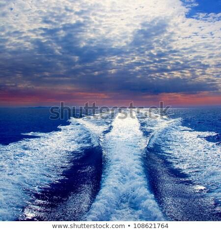blue sea ocean with boat wake prop wash foam stock photo © lunamarina