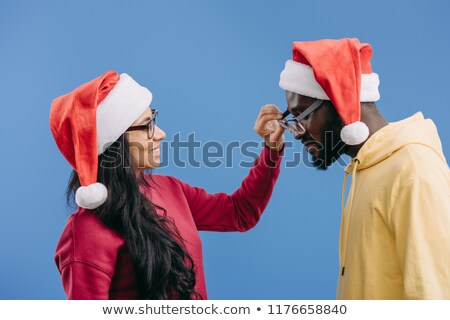 casual couple with man taking womans hat off stock photo © feedough