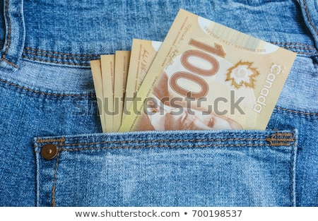 Stock photo: Blue jean and canadian dollars
