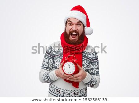 male santa with alarm clock studio shot stock photo © stockyimages