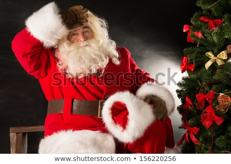 santa claus looking tired after delivering all gifts to children stock photo © hasloo