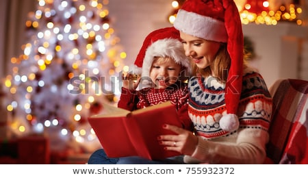 santa claus sitting indoors at dark room near christmas tree and stock photo © hasloo