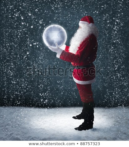 santa claus holding snow globe stock photo © hasloo