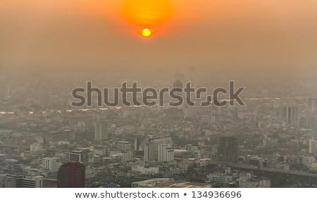 Kilátás Bangkok sziluett mutat naplemente szmog Stock fotó © meinzahn