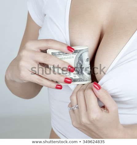 Woman with cash in bra Stock photo © AndreyPopov