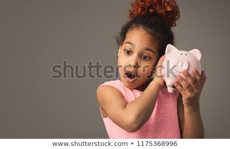 mosolyog · fiú · tart · rózsaszín · disznó · pénz - stock fotó © nikkos