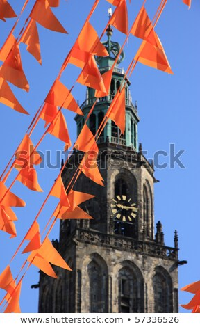 Martinitower in Groningen, The Netherlands with flags Stock photo © Hofmeester