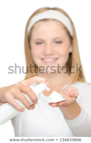 Cheerful teenager girl using cleaning foam cream Stock photo © CandyboxPhoto