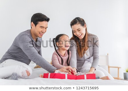 Hispanic family exchanging gifts at Christmas Stock photo © monkey_business