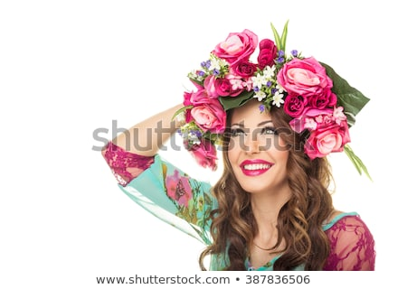 cheerful beautiful young brunette woman with flower in her long hair stock photo © nejron