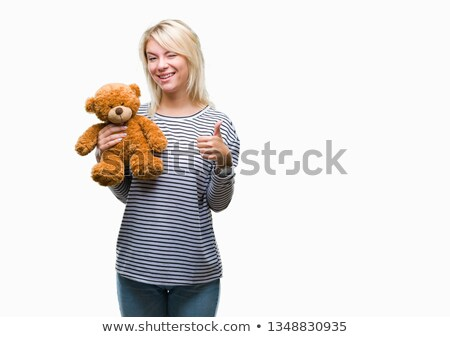 young woman holding teddy bear and showing thumbs up sign stock photo © bmonteny
